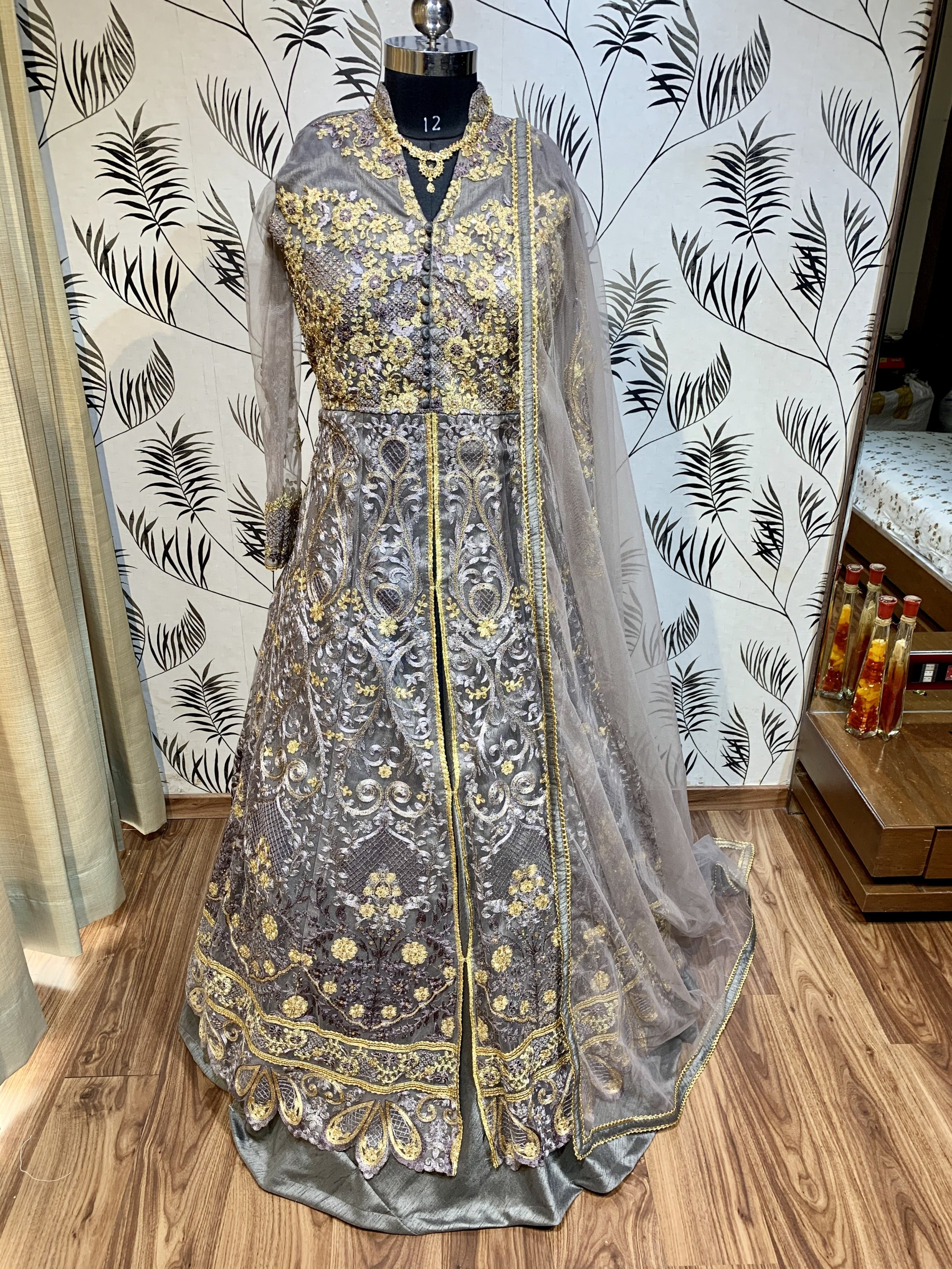 Crystal Stone Work Soft Premium Net Party Wear Lehenga In Grey Color