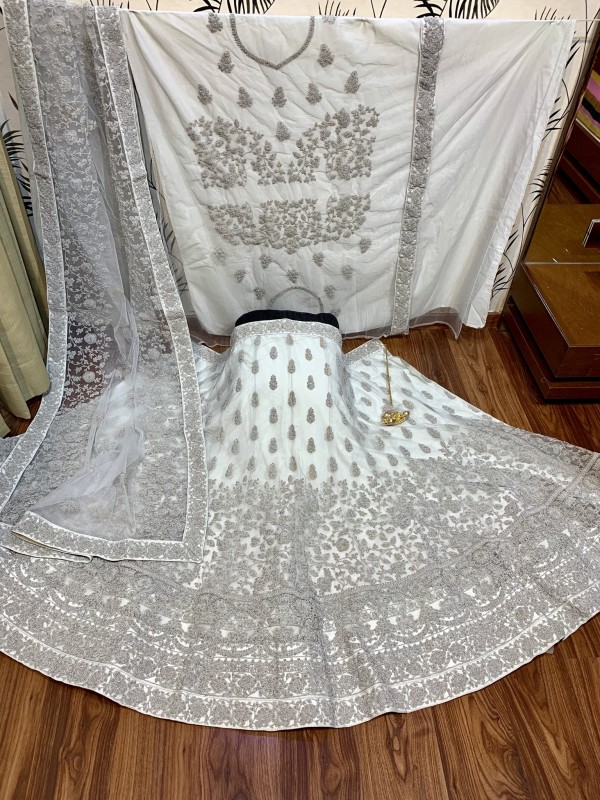 Soft Premium Net Party Wear Lehenga In Grey With Embroidery & Crystal Work