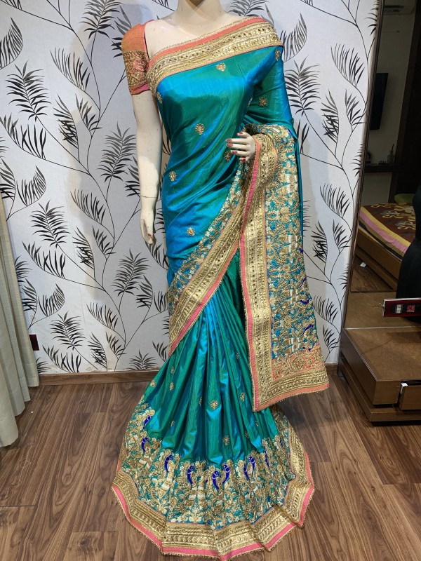 Mal Mal Silk Wedding Wear Saree In Turquoise color With Embroidery Work & Crystal stone work