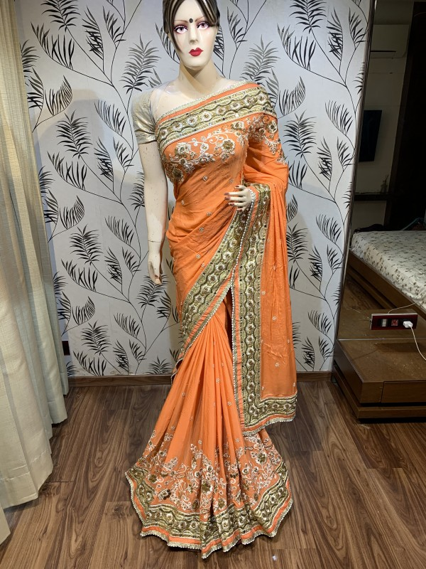 Pure Georgette Wedding Wear Wear Saree In Orange With Embroidery Work & Stone Work
