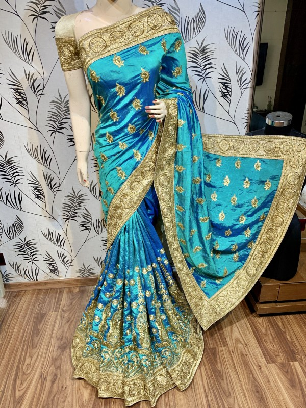 Pure Heritage Silk Wedding Wear Saree In Sky Blue With Embroidery & Crystal Stone Work