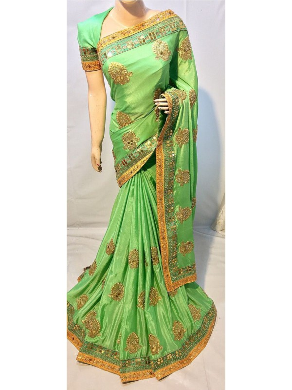 Metallic Silk Party Wear Saree In Light Green With Crystal Stone Work