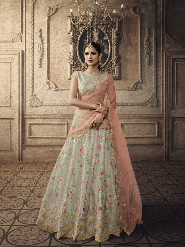 Soft Premium Net Wedding Wear Lehenga In Light Green With Embroidery & Stone Work
