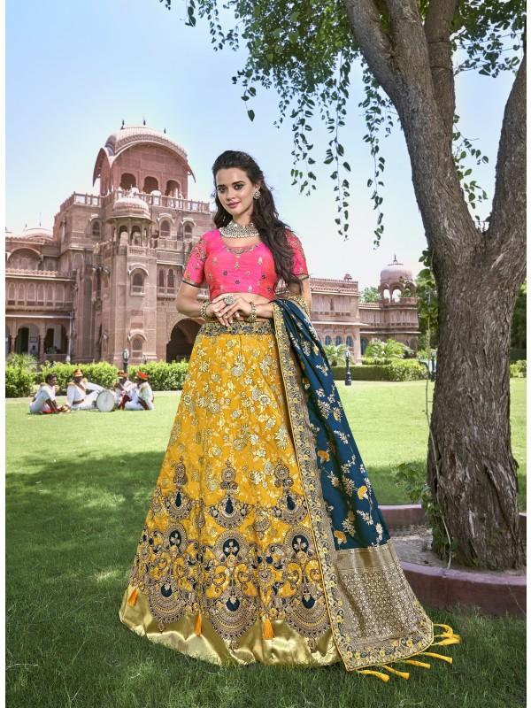 Pure Banarasi Silk Wedding Lehenga in Yellow & Blue With Embroidery and stone work
