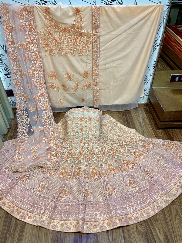 Soft Premium Net Party Wear Lehenga In Peach WIth Embroidery & Pearl Work