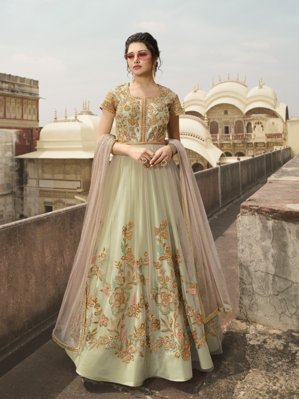 Soft Premium Net Wedding Wear Gown In Light Green With Embroidery & Crystals Stone Work