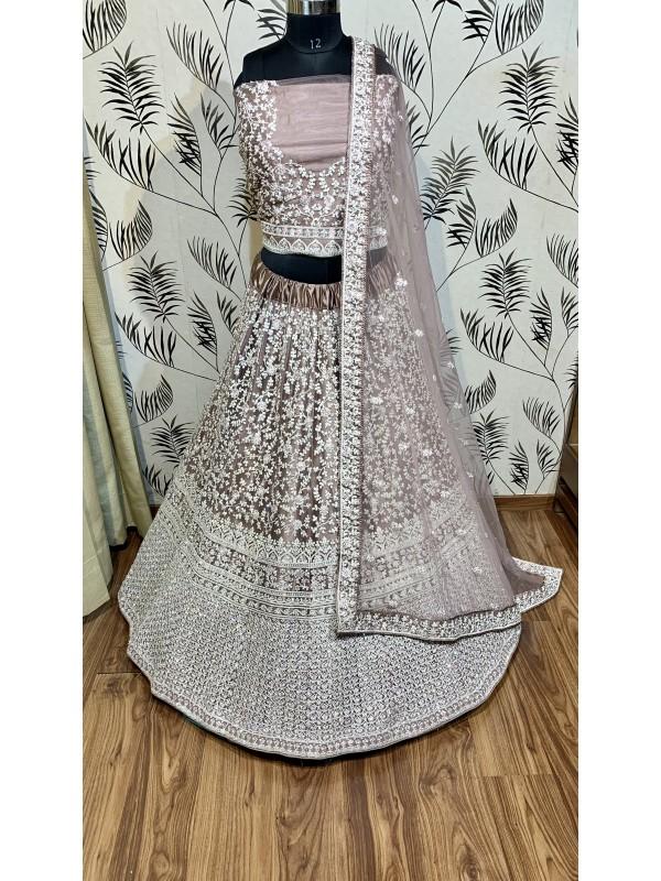 Soft Premium Net Wedding Wear Lehenga In Dusty Pink  With Luckhnowi Work & Stone Work