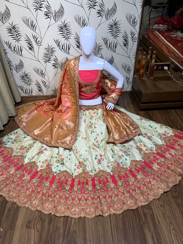 Pure Banarasi Silk Wear Lehenga In Off White Color with Embroidery & Pearl Work