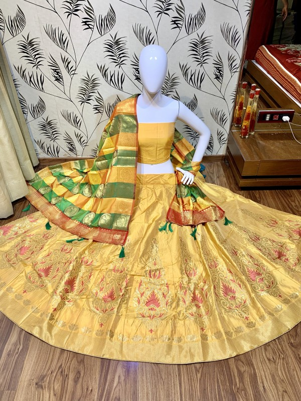 Pure Jecquard Silk Mehendi Sangeet Wear Lehenga In Yellow Color