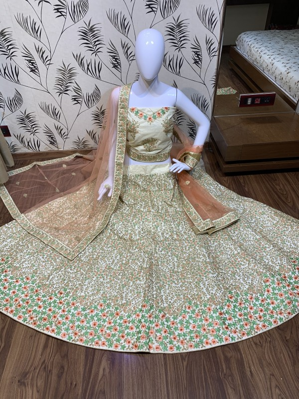 Butter Silk Party Wear Lehenga In Cream With Embroidery & Stone Work