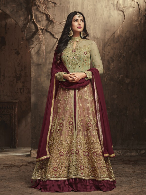 Soft Premium Net Wedding Wear Gown In Maroon With Stone Work