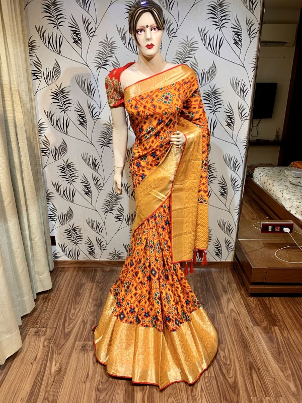 Dola Natural Dola Silk Wedding Saree In Light Orange with Embroidery and stone work