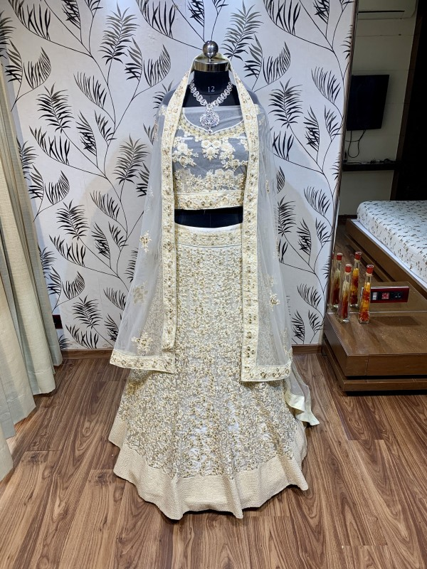 Soft Premium Net Wedding Lehenga In Off White Color With Embroidery Work & Pearl Work