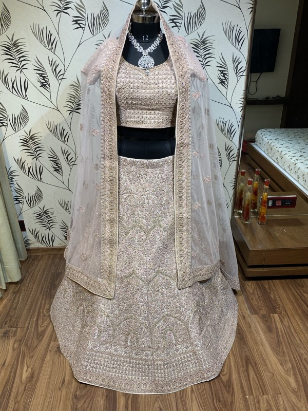 Pure Silk Wedding Wear Lehenga In Cream With Embroidery Work