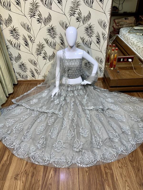 Soft Premium Net Wedding Wear Lehenga In Grey With Embroidery & Stone Work