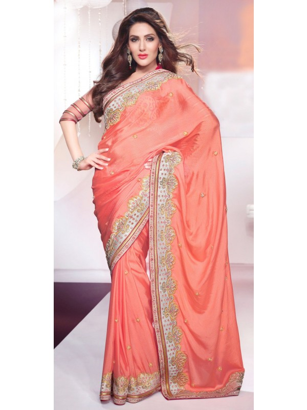 Pure Crape Silk Party Wear Saree In Peach With Crystal Stone Work